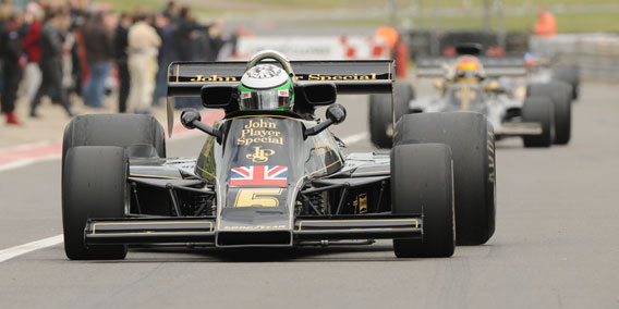 Heikki Kovalainen Drives Checkered Past Racing Lotus 77