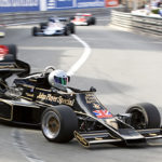 Running at the historic Monaco Grand Prix circuit in the Lotus 77 with a Ferrari 312-T behind.