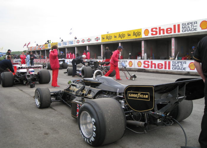 Checkered Past Racing's Chris Locke prepares to demonstrate the 1976 Lotus 77 for the filming of the movie Rush