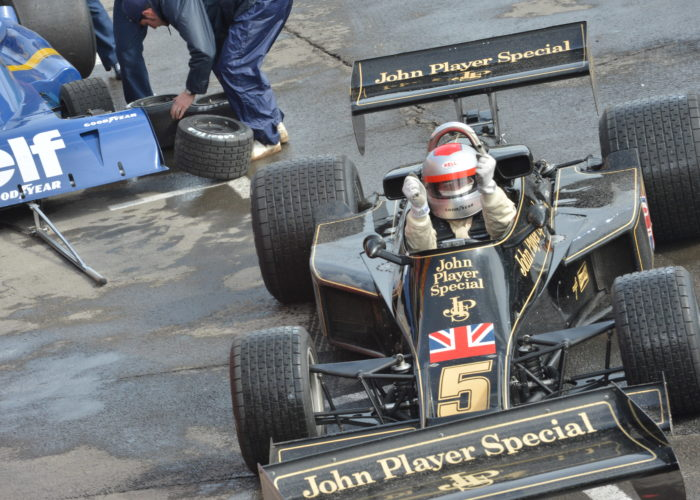 Checkered Past Racing's Chris Locke jubilant after a brilliant run in the 1976 Lotus 77 at Monaco